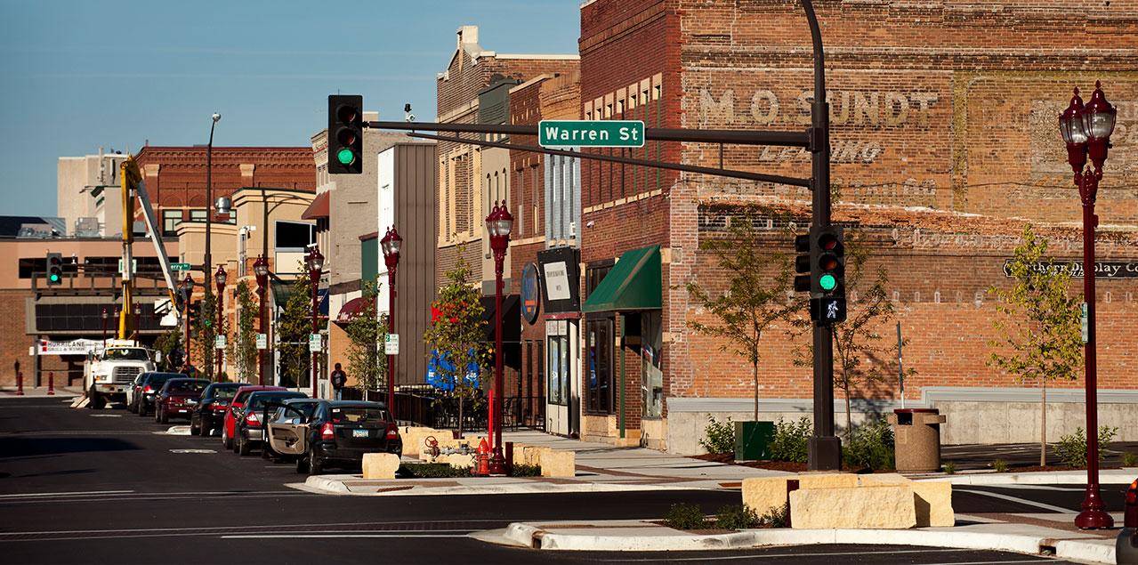 buildings, street lamps, and walking corridor on city street