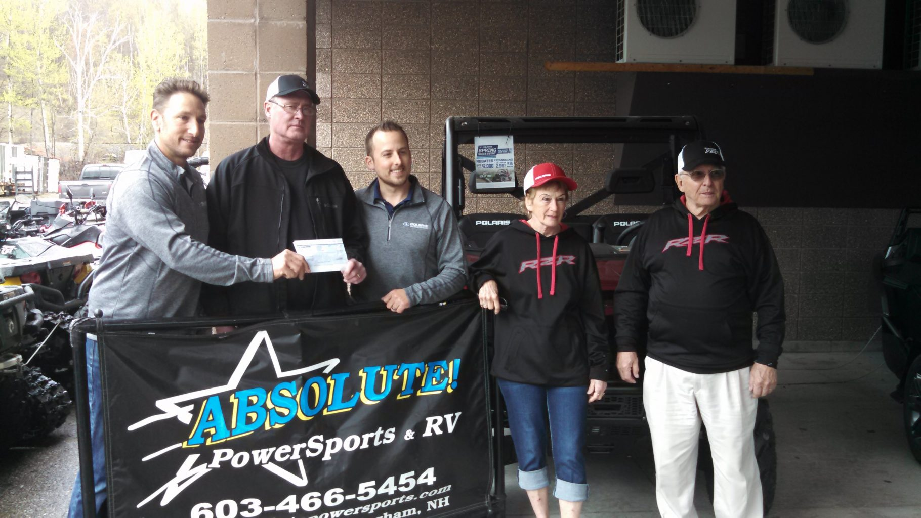 Polaris giving out a trails grant check