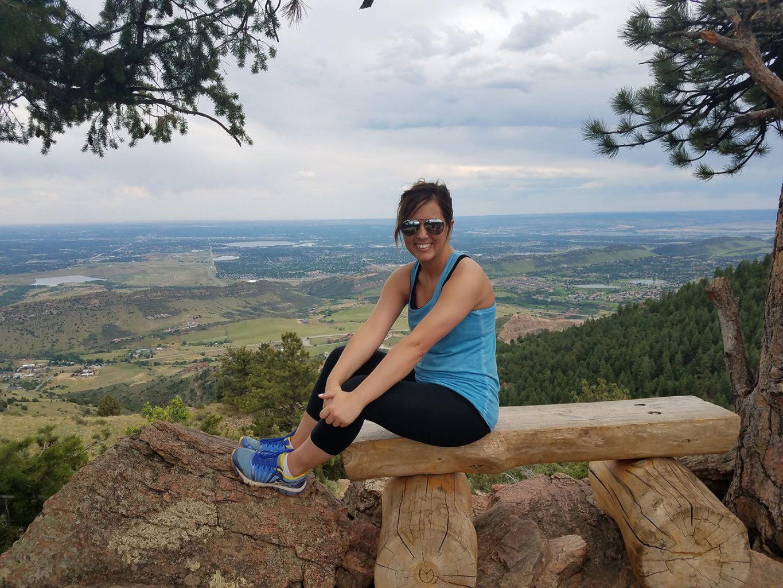 woman taking a break from hiking in Colorado