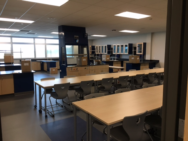 high school classroom with large tables on wheels for desk space