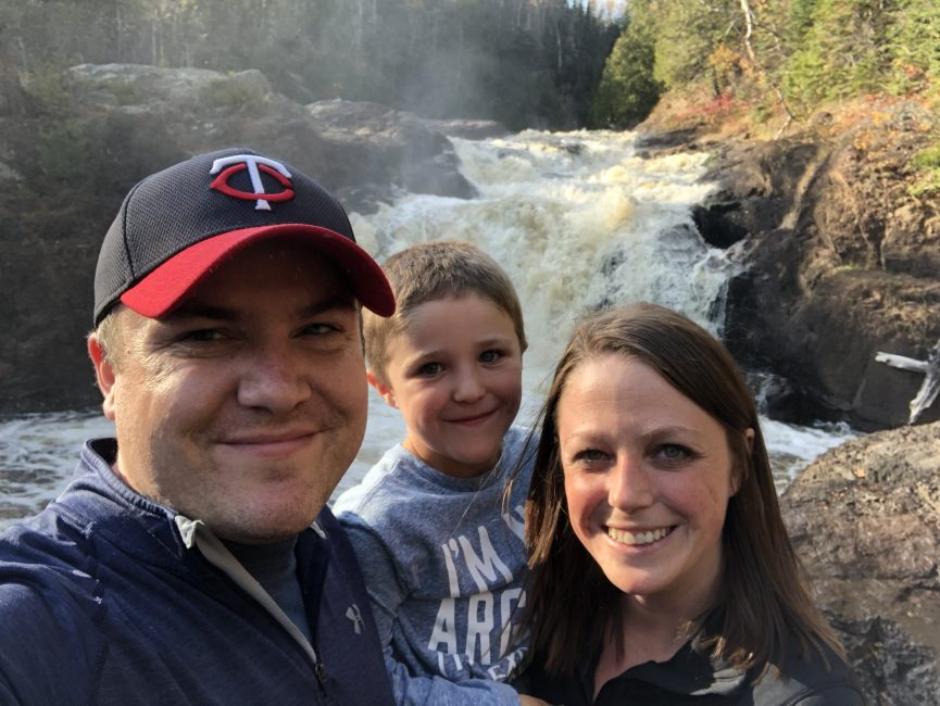mom, dad, and son in front of waterfall
