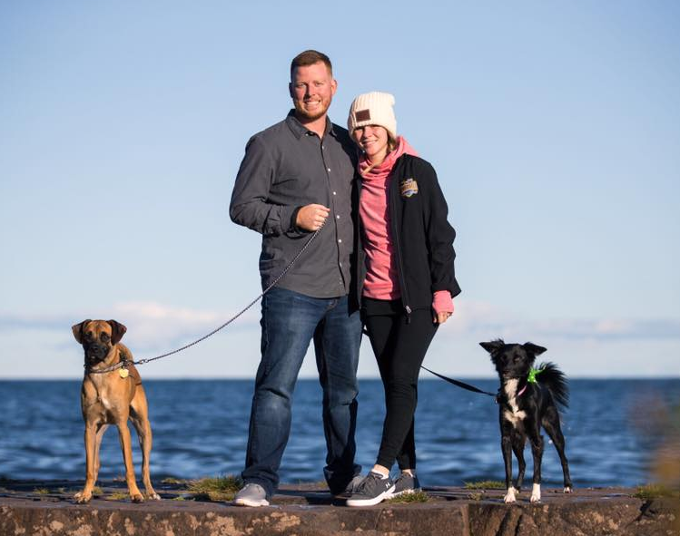 Darin and his fiancé Kelsey with their dogs Halsey and Stryker.